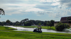 July 26, 2014 - a man fishing fishing in the afternoon in pond by Main Clubhouse in Kings Point