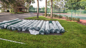 July 26, 2014 - New rolls of green fencing by tennis courts in Kings Point