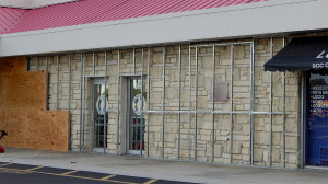 Aug 17, 2014 - Outdated white brick covered by plywood in Sun City Center Plaza