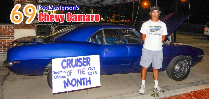 Pat Masterson, of Sun City Center, standing in front of his blue 69 Chevy Camaro that was awarded by Roamin' Oldies the 'Cruiser Of The Month for October 2013