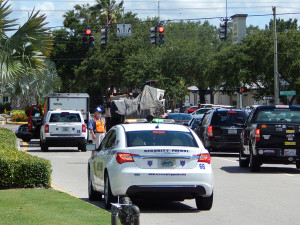 Sun City Center Security Patrol cars at scene with stalled truck at SR 674 and N Pebble Beach