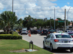 Sun City Center Security Patrol sets up cones deflecting traffic from stalled truck at SR 674 and N Pebble Beach