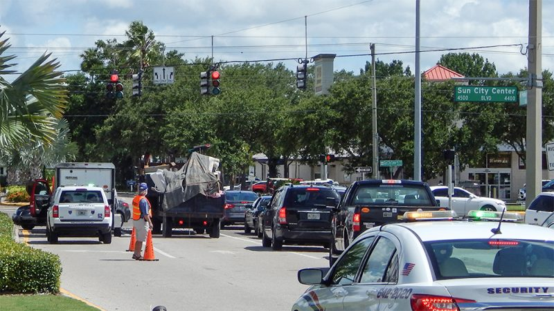Sun City Center Volunteer Security Patrol sets up cones deflecting traffic from stalled truck at SR 674 and N Pebble Beach