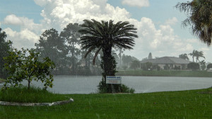 July 14, 2014 - Sun and rain at Shimmering Lake on Rickenbacker Dr in Sun City Center, FL