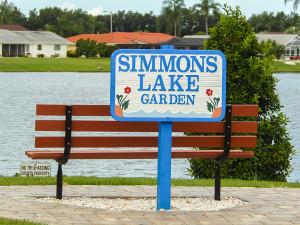 Wooden bench at Simmons Lake Garden on S Pebble Beach Blvd, Sun City Center, FL