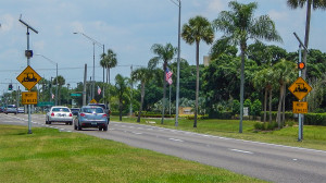 Yellow flashing warning lights on eastbound S.R. 674 alert motorist to watch out for golf carts for the next 1.2 miles in Sun City Center FL