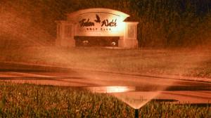 Automated sprinklers turn on at night near Falcon Watch Golf Club in Kings Point