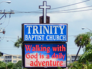 Baptist LED sign reads 'Walking With God Is A Daily Adventure' along 674 in Sun City Center, FL