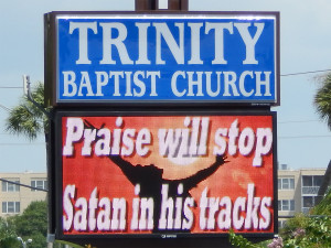 LED at Baptist church displays 'Praise Will Stop Satan In His Tracks' along 674 in Sun City Center