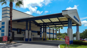 Aug 13, 2014 - South Bay Hospital with Ambulance Patient Dropoff portico in back in Sun City Center, FL