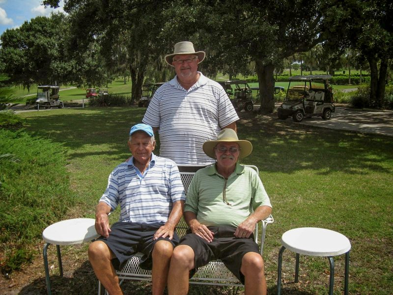 Standing: Ruben Jones. Seated Left to Right: Don Mowry and Paul Swakow at Sandpipers Golf Course, Sun City Center, FL