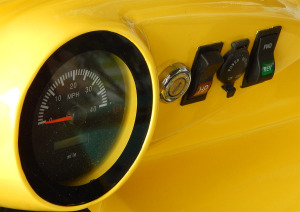 Speedometer, milage, reverse and forward switch on dashboard of Roadster golf cart by STARev
