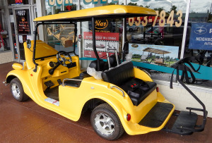 Yellow Roadster 2 plus 2 seat golf cart by STARev