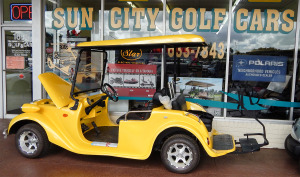 Yellow Star Roadster golf cart in front of Sun City Center Golf Carts
