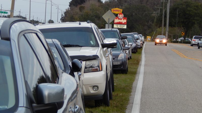 Cars parked on side of road on 33rd Street for Ribbon Cutting Ceremony of Inspired Living at Sun City Center FL Jan 7, 2015