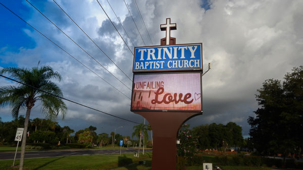 Trinity Baptist Church sign reads Unfailing Love in Sun City Center