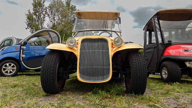 Front grill of yellow California Roadster Golf Cart