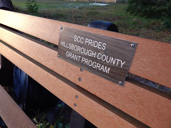 MAY 24, 2015 - A bench with plaque - SCC Prides Hillsborough County Grant Program - on 674, Sun City Center, FL