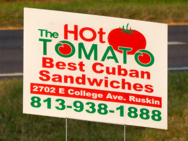 MAY 24, 2015 - Advertisment sign for The Hot Tomato best Cuban Sandwiches