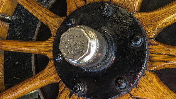 Feb 22, 2017 - Original Ford hub cap that reads Made in USA (W) on wooden spoked tire on Model T Ford/suncitycenterphotos.com